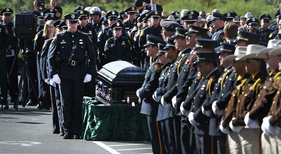 Detective Benjamin Marconi made the ultimate sacrifice. We will mourn him, but we will never waver in our commitment to those we have sworn to protect. Photo: Bob Owen /San Antonio Express-News / ©2016 San Antonio Express-News