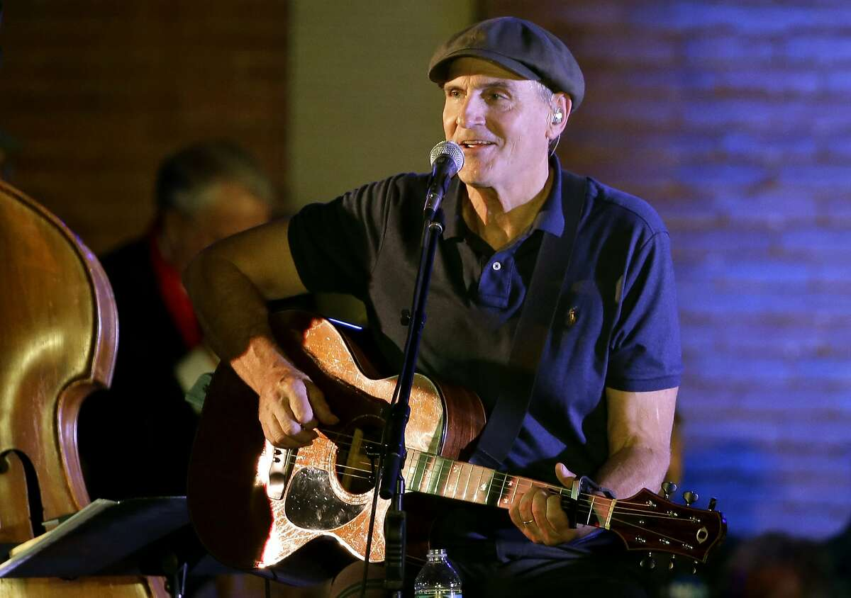 FILE - In this Nov. 6, 2016 file photo, musician James Taylor performs during a campaign event for Democratic presidential candidate Hillary Clinton, in Manchester, N.H. Taylor has a Thanksgiving message for his fans: Gratitude improves your attitude. The singer says in an email that giving thanks is the key to overcoming setbacks and dealing with reversals of fortune. (AP Photo/Steven Senne, File)