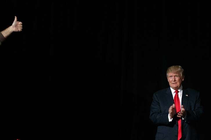Republican presidential candidate Donald Trump arrives to speak to a campaign rally, Monday, Oct. 31, 2016, in Warren, Mich. (AP Photo/ Evan Vucci)
