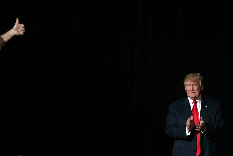 Republican presidential candidate Donald Trump arrives to speak to a campaign rally, Monday, Oct. 31, 2016, in Warren, Mich. (AP Photo/ Evan Vucci) Photo: Evan Vucci, Associated Press