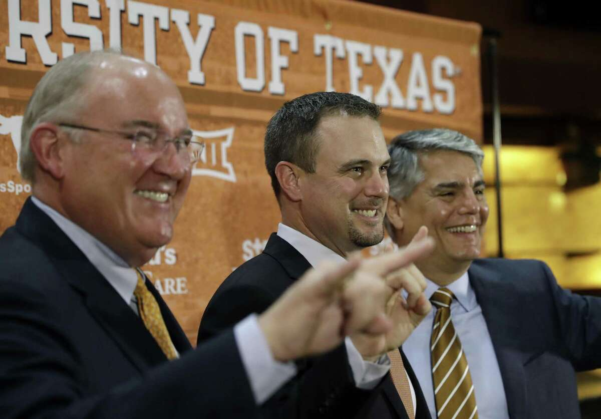 Tom Herman (center) poses with athletic director Mike Perrin (left) and school president Gregory Fenves during a news conference where he was introduce at Texas' new head football coach on Nov. 27, 2016, in Austin.