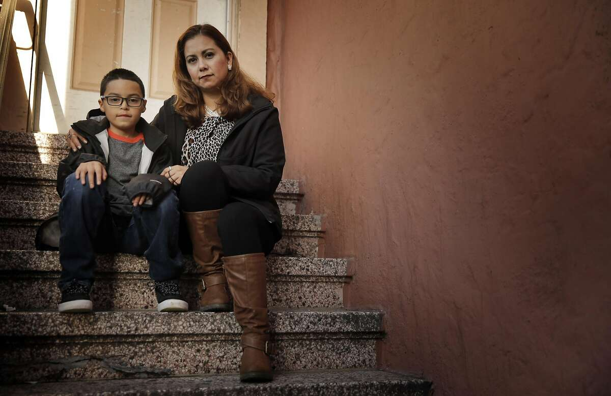 Norma Ortiz with her son, Brandon Constantino, 9, in Daly City, Calif., on Monday, November 28, 2016. Ortiz who was jailed after reporting her boyfriend for domestic violence because he said she was hitting him too. She was threatened with deportation but now has legal status after getting a good lawyer.