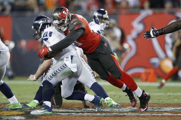 TAMPA, FL - NOVEMBER 27: Ryan Russell #96 of the Tampa Bay Buccaneers sacks Russell Wilson #3 of the Seattle Seahawks in the fourth quarter of the game at Raymond James Stadium on November 27, 2016 in Tampa, Florida. The Buccaneers defeated the Seahawks 14-5. (Photo by Joe Robbins/Getty Images)