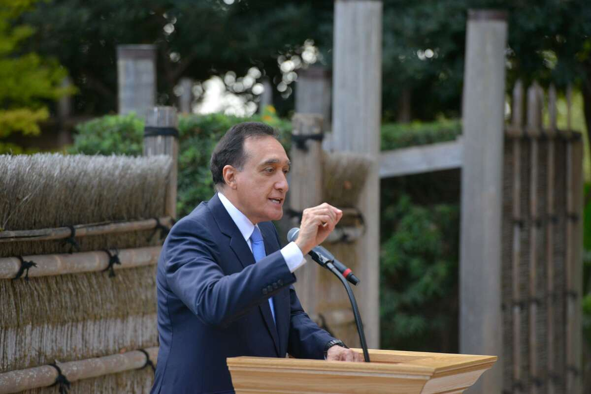 Former San Antonio Mayor Henry Cisneros speaks during a ceremony unveiling the statue of Naoko Shirane at the San Antonio Botanical Garden on Monday afternoon.