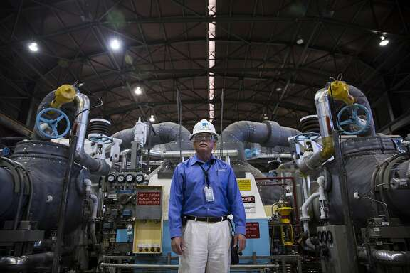 Monday August 24, 2015 Jearl Strickland director of Director Technical Services at Pacific Gas and Electric Company Diablo Power Plant stands in front of the electricity generating Turbine 2, located in the Diablo Canyon Power Plant in San Luis Obispo County, Calif. (Nancy Pastor/For the San Francisco Chronicle)