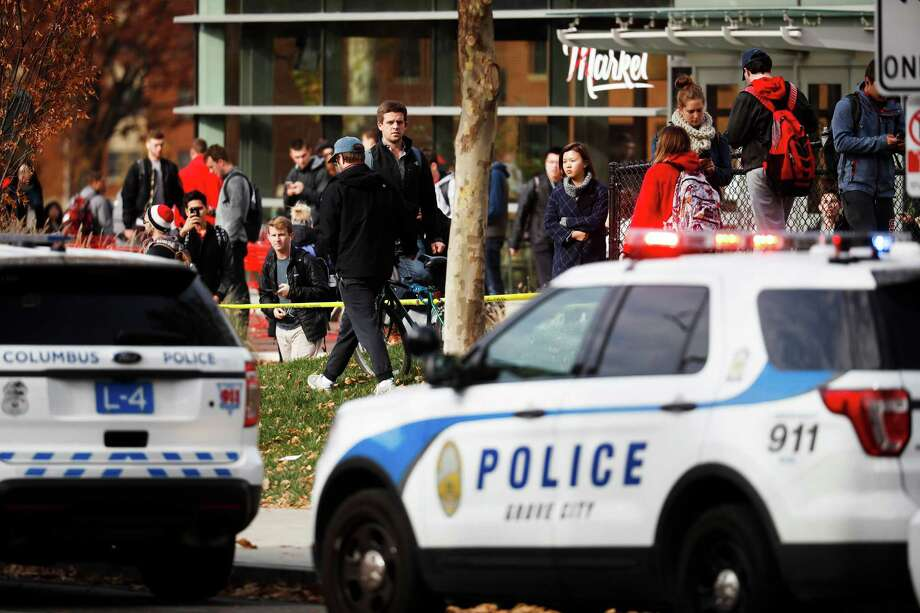 Students leave buildings surrounding Watts Hall as police respond to reports of a shooting on campus at Ohio State University, Monday, Nov. 28, 2016, in Cincinnati. (AP Photo/John Minchillo) Photo: John Minchillo, STF / AP
