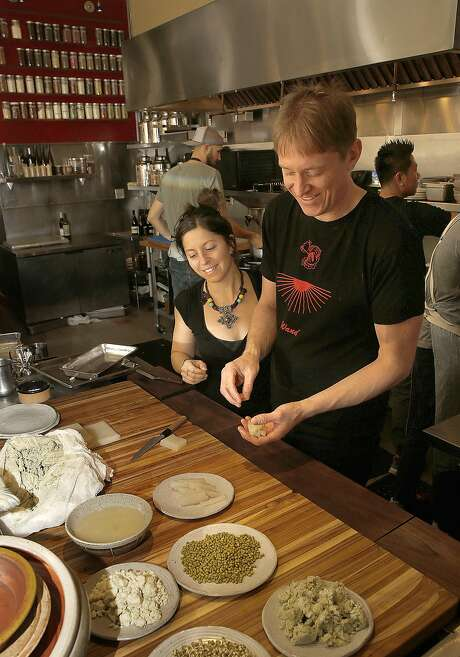 Chefs Cortney Burns (left) and Nick Balla in the kitchen at their pop-up, Motze. Photo: Liz Hafalia, The Chronicle