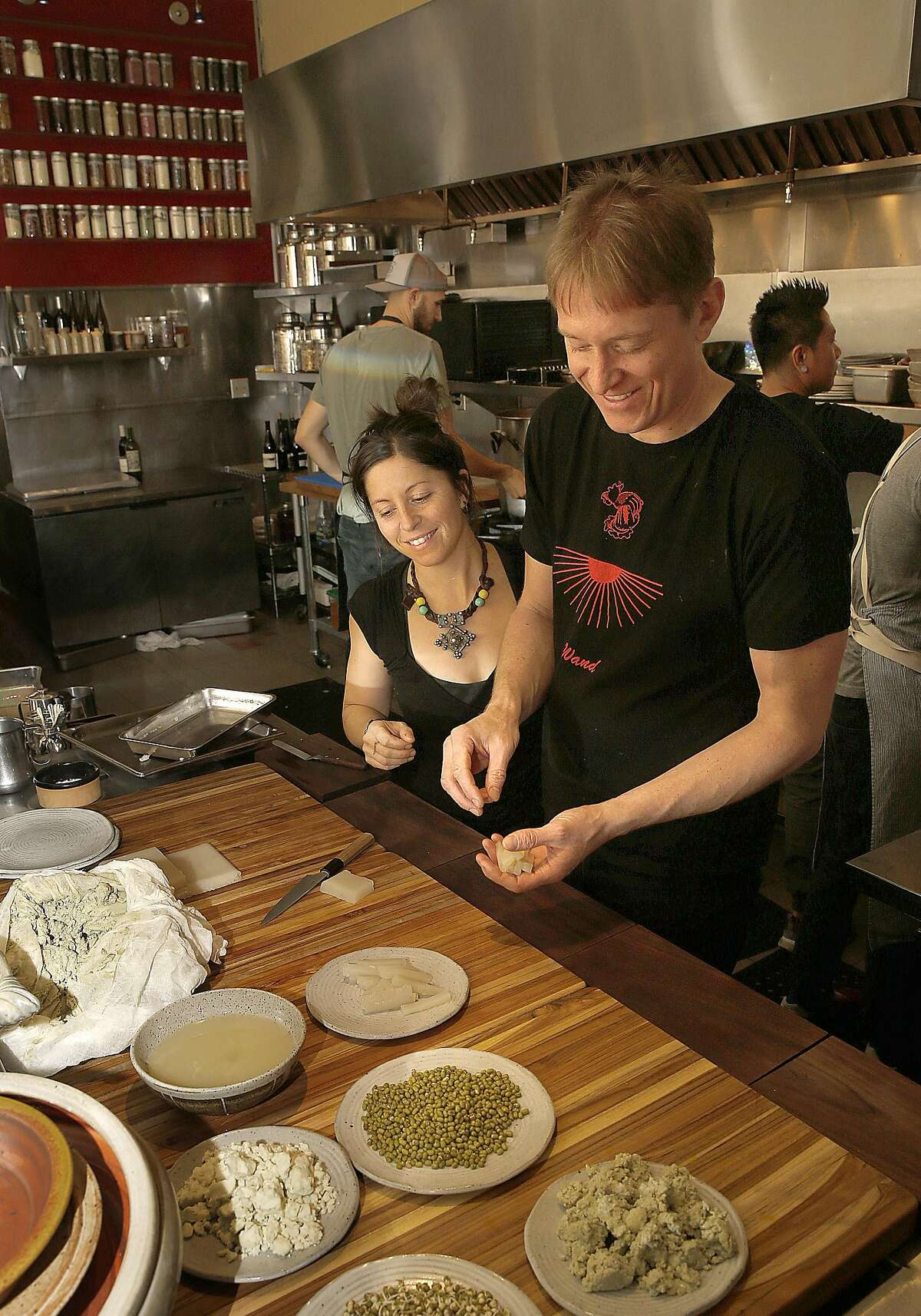 Chefs Cortney Burns (left) and Nick Balla (right) cook at Motze on Friday, November 18, 2016, in San Francisco, Calif.
