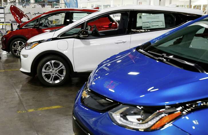 Chevrolet Bolt EV vehicles are displayed during a tour of the General Motors plant in Orion Township, Mich.