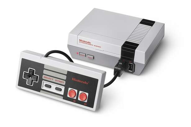 An undated handout photo of Nintendo's NES Classic Edition game console. Since its release on Nov. 11, 2016, The smaller version of the original console introduced to North America in 1985 has become one of the hottest gift items of the year. (Nintendo via The New York Times) -- NO SALES; FOR EDITORIAL USE ONLY WITH STORY SLUGGED ___  BY SCHONBRUN FOR NOV. 28, 2016. ALL OTHER USE PROHIBITED.