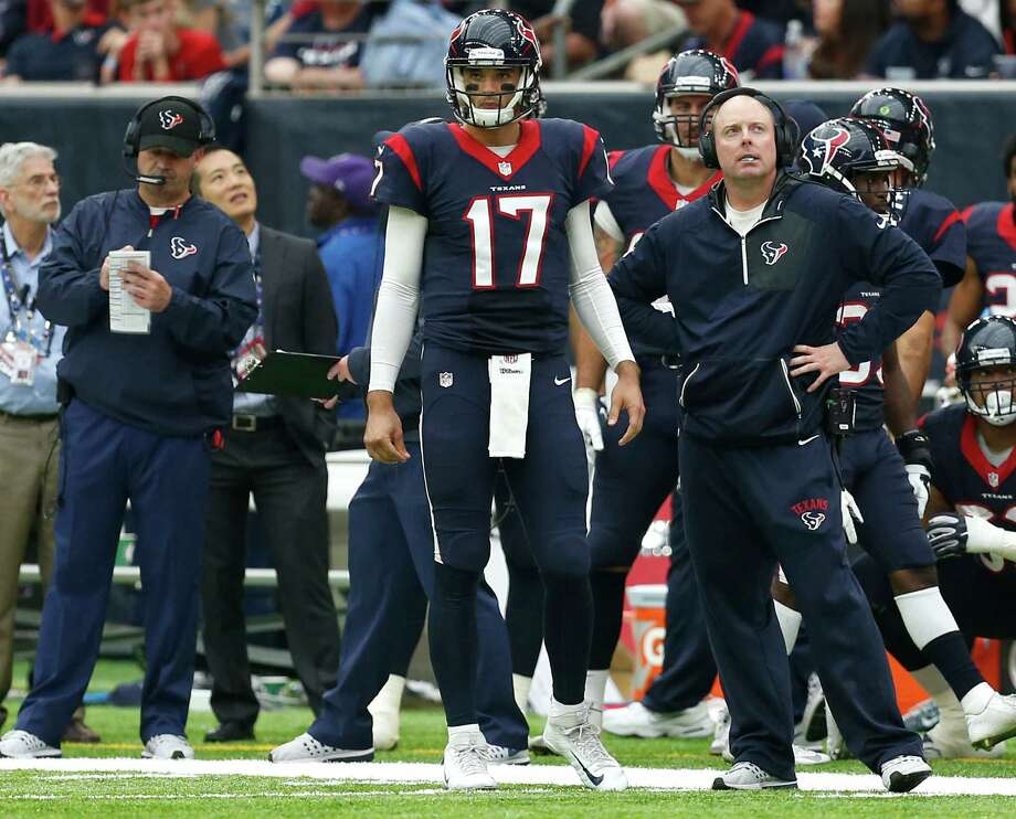 The Texans hope the 6-8 Brock Osweiler, center, stands tall for what has been a largely impotent offensive unit come Saturday in their wild-card game against the Raiders. Osweiler returns to the helm after being benched following 14 games as the starter. Photo: Brett Coomer, Staff / © 2016 Houston Chronicle