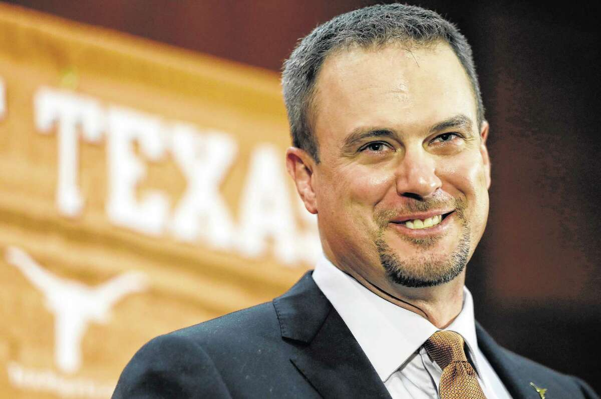 An exhausted but happy Tom Herman will whistle while he works as Texas' new coach.
