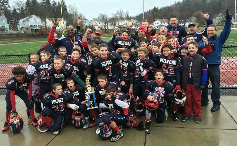 The Milford Pop Warner Eagles junior pee wee football team, the Connecticut champions, defeated the Massachusetts state champion Hyde Park Cowboys 13-6 last week to win the New England title. The Eagles beat the Trumbull Rangers 34-6 to win the Southern Connecticut state championship before their 19-7 victory over Middletown, R.I., in the regional semifinal. Milford, coached by Jesse Rohleder, became one of eight teams to advance to the national championship tournament in Walt Disney World, Orlando, Fla. Photo: Contributed / Contributed Photo / Connecticut Post Contributed