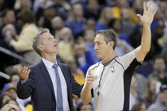 Warriors head coach Steve Kerr questions a referee about a foul call against Klay Thompson (11) in the first half as the Golden State Warriors played the Atlanta Hawks at Oracle Arena in Oakland, Calif., on Monday, November 28, 2016.