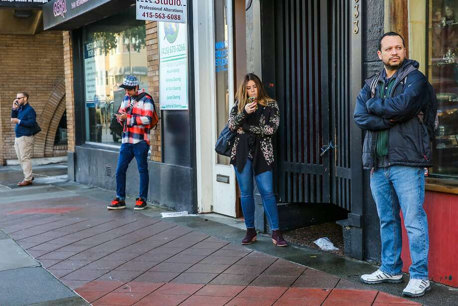 Kayla Jossey (second from right) and Daniel Garcia wait on Union Street in San Francisco for a Chariot van they will take to work. Photo: Gabrielle Lurie, The Chronicle