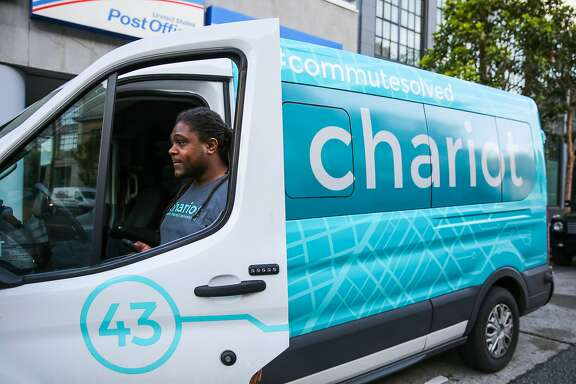Vincent Jones, a driver for Chariot commuter-van service gets out of his van to take a break, in San Francisco, California, on Monday, November 28, 2016.