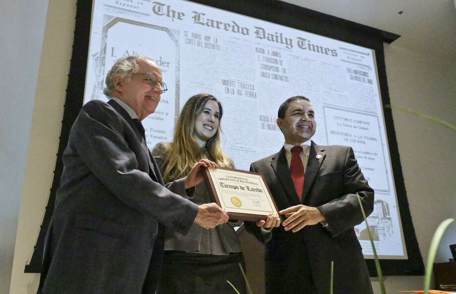 Congressman Henry Cuellar, right, presents Laredo Morning Times Publisher William Green and Spanish Editor Melissa Santillana with a congressional certificate of recognition Monday during the Tiempo de Laredo 90th Anniversary Ceremony at the Texas A&M International University Student Center. Photo: Victor Strife /Laredo Morning Times