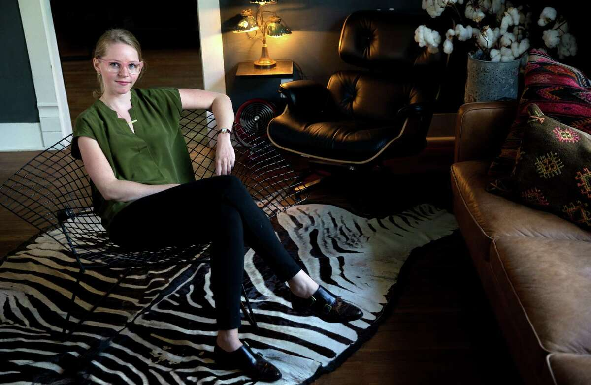 Julia Gabriel, shown at her Heights home, is a Houston designer who produces handmade leather bags.