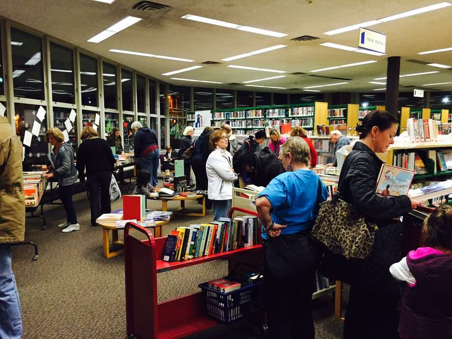 Shoppers browse for books at the Friends of the Milford Library's winter 2015 sale Photo: Contributed Photo