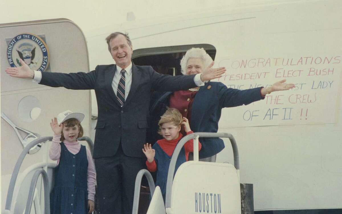 President-elect George Bush, his wife, Barbara, and their granddaughters Jenna, left, and Barbara wave to well-wishers at Ellington Field the day after his 1988 election victory.