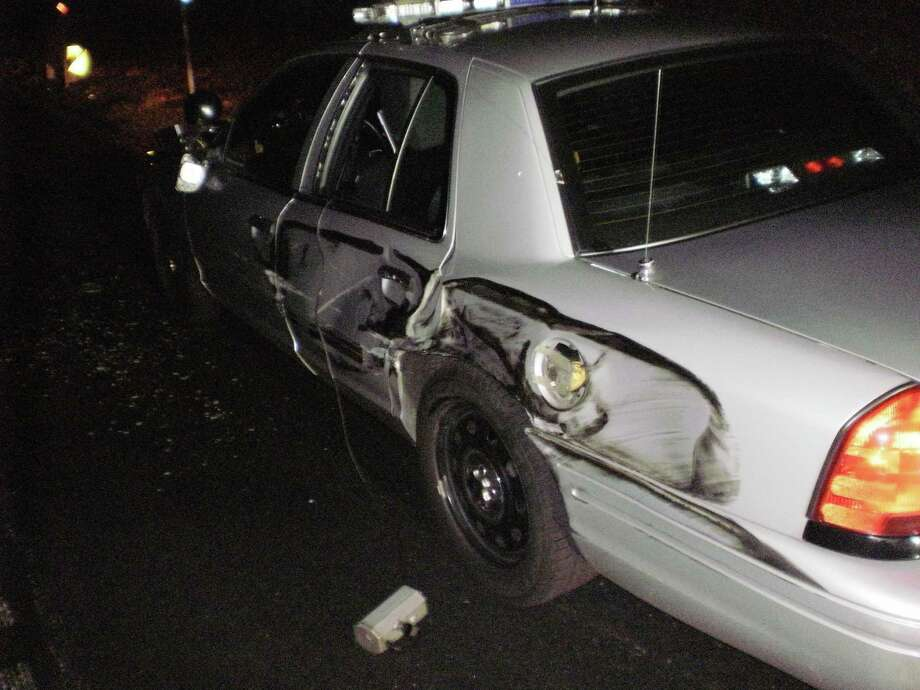 A State Police trooper received minor injuries after his cruiser, parked along the right shoulder of I-95 in Waterford, was sideswipped by a tractor-trailer truck on Tuesday, Nov. 29, 2016. After hitting the cruiser, the trucker driver did not stop. The rear, driver's side of the cruiser was damaged from the collision. It had to be towed from the scene. Photo: State Police