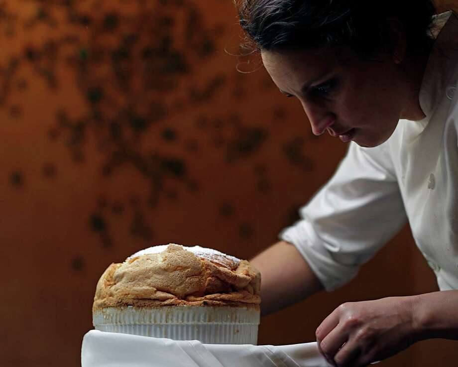 Tony's chef de cuisine Kate McLean adds the finishing touches to a Cannoli Souffle. Photo: James Nielsen, Staff / © 2016  Houston Chronicle