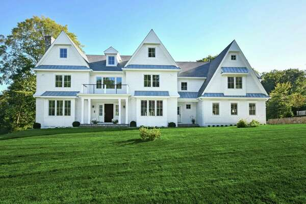 The newly constructed white colonial house at 42 Hillcrest Road was designed and built by the seasoned team of high-end residential specialists on a one-acre property.