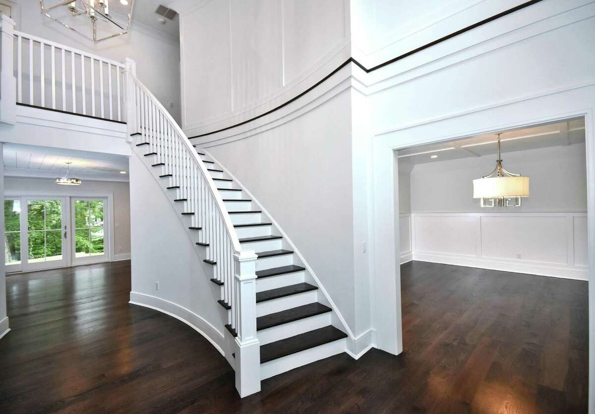 The curves of the foyer walls and the half crescent-shaped stairwell provide a graceful sophistication.