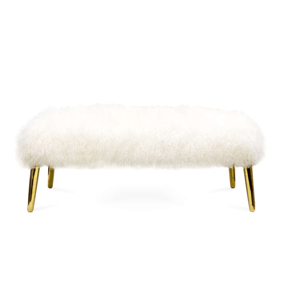 Jonathan Adler's Mongolian Lamb Bench features a plush fur-covered cushion and matte brass tapered legs.