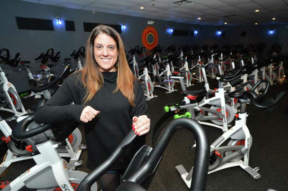 Above, owner Amy Hochhauser stands near some of the 46 bikes in her JoyRide Cycling and Fitness Studio, below, on Monday in Westport. Photo: Alex Von Kleydorff / Hearst Connecticut Media / Connecticut Post
