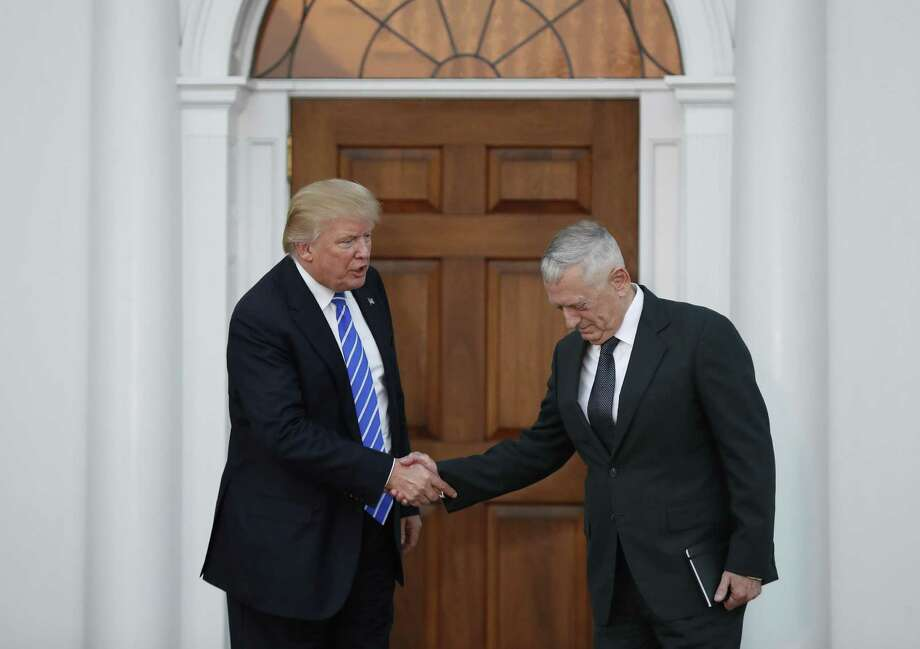 President-elect Donald Trump shakes hands  with retired Marine Corps Gen. James Mattis at Trump National Golf Club Bedminster clubhouse in Bedminster, N.J., Saturday, Nov. 19, 2016. (AP Photo/Carolyn Kaster) Photo: Carolyn Kaster, STF / Associated Press / AP