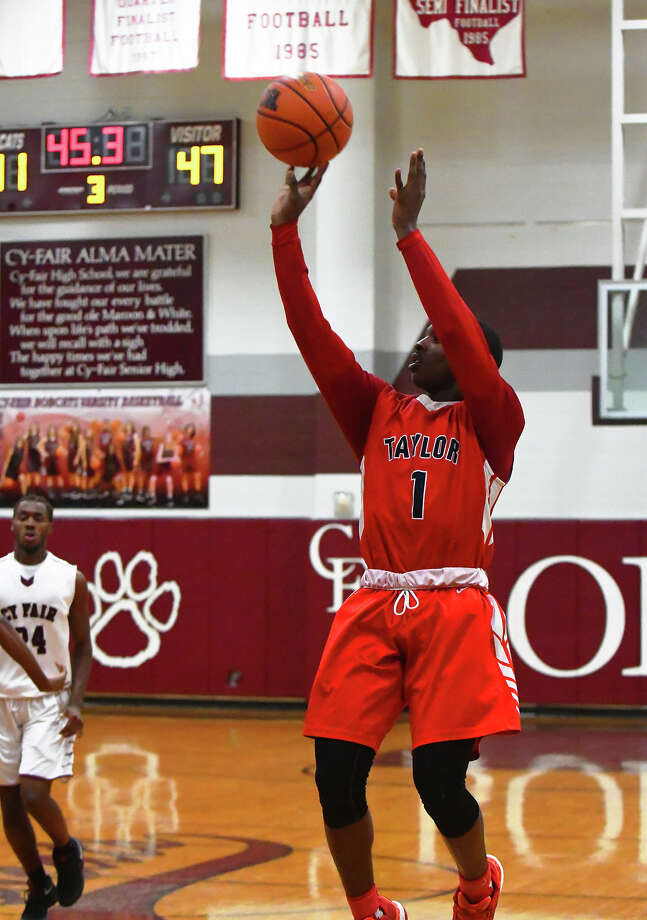 Alief Taylor junior guard Kavin Ezekwe was a nightmare for the Cy-Fair defense all night long Monday. Ezekwe finished with a game-high 29 points, connecting on five shots from behind the arc. Photo: Tony Gaines / HCN