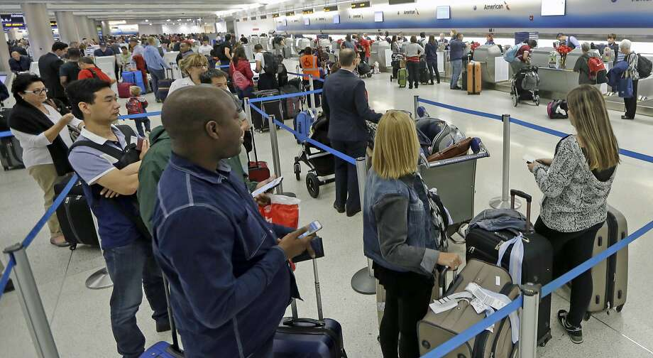 """These days, flights are going out almost at full capacity. That means if you miss your flight or if it's canceled, you don't have a lot of time to snag a seat on the next one,"" says Johnny DiScala of online travel resource JohnnyJet.com. Photo: Alan Diaz, Associated Press"
