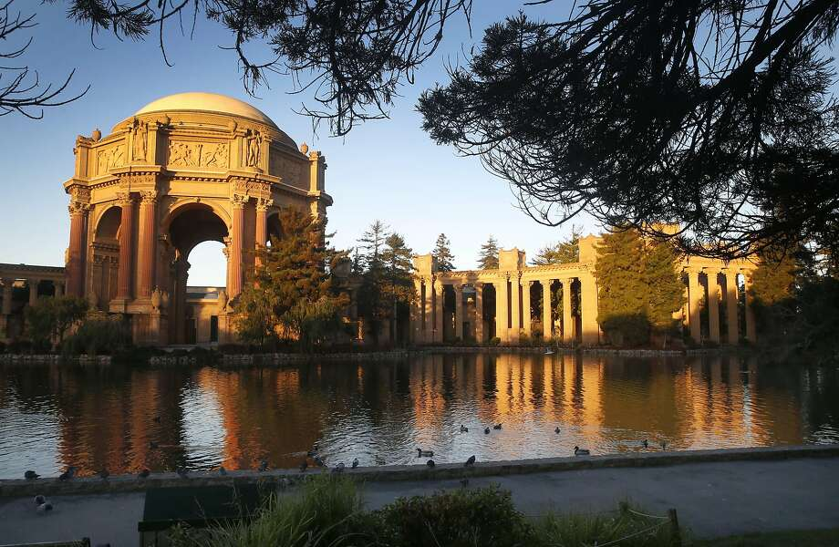 The Palace of Fine Arts is illuminated at sunrise in San Francisco, Calif. on Tuesday, Nov. 29, 2016. Photo: Paul Chinn, The Chronicle