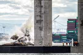 A marine foundation from the old eastern span of the old Bay Bridge is blown up on Saturday, Oct. 29, 2016 in San Francisco, Calif. Pier E4 was demolished in less than four seconds with 12,000 pounds of explosives. Next year, six foundations will be blown up, and their remains dredged and hauled away. Seven more are scheduled for implosion in 2018.
