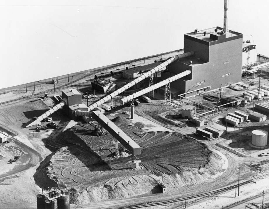An overall view of the SECO project. The 4.5-acre wood chip pile is to the left of the plat. The tubes house belt conveyors that bring wood into the plant. The background of this aerial photograph was masked by Dow Corning to protect proprietary secrets. Photo: Daily News File Photo