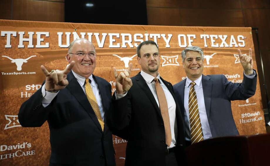 Tom Herman, center, poses with athletic director Mike Perrin, left, and school president Gregory Fenves, right, during a news conference where he was introduced at Texas' new head NCAA college football coach, Sunday, Nov. 27, 2016, in Austin. (AP Photo/Eric Gay) Photo: Eric Gay/Associated Press