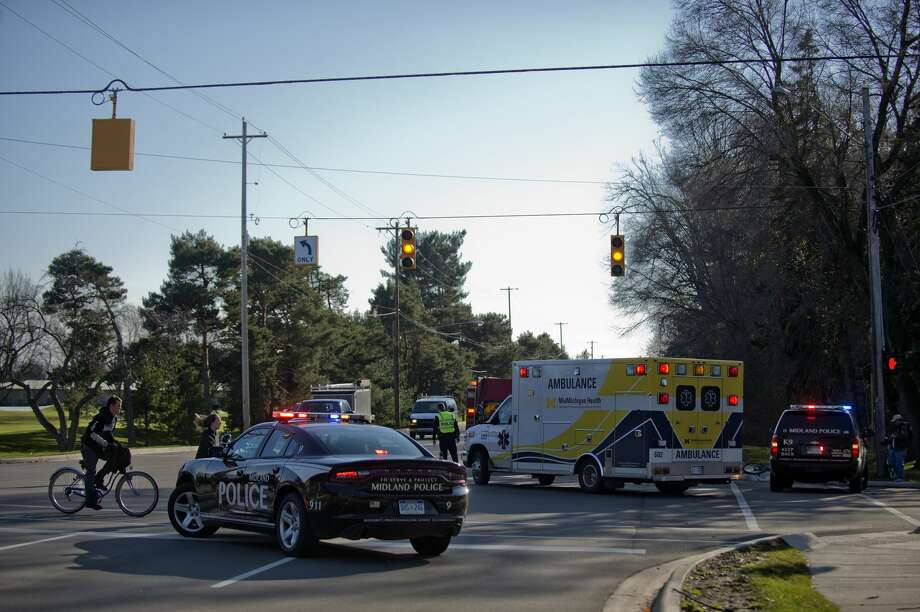 Midland police, firefighters and MidMichigan Medical Center-Midland EMS respond to an accident at the corner of Eastman Avenue and Sugnet Road. Photo: Brittney Lohmiller/Midland Daily News/Brittney Lohmiller