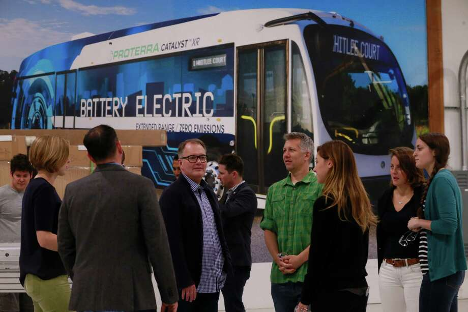 Members of engineering team gather at the headquarters of Proterra, an electric bus company at its headquarters in Burlingame, Calif., as seen on Sept. 22. A photo of their Catalyst XR electric bus covers a wall in the background. Photo: Michael Macor, The Chronicle / ONLINE_YES