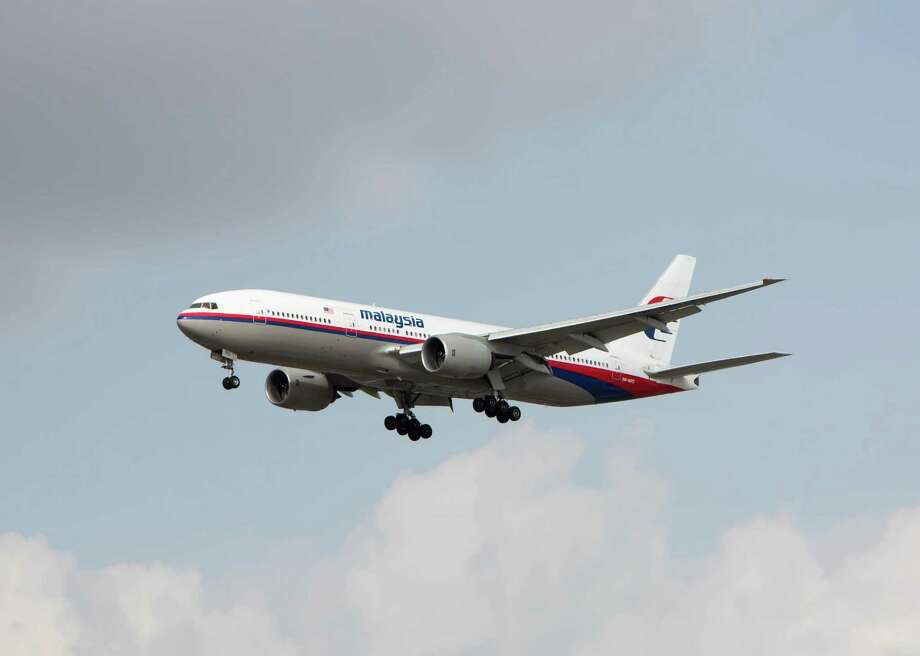 9M-MRO, an 11-year old Boeing 777, on approach to Los Angeles International Airport three months before it disappeared. Photo: Jay Davis / Contributed Photo / Connecticut Post Contributed