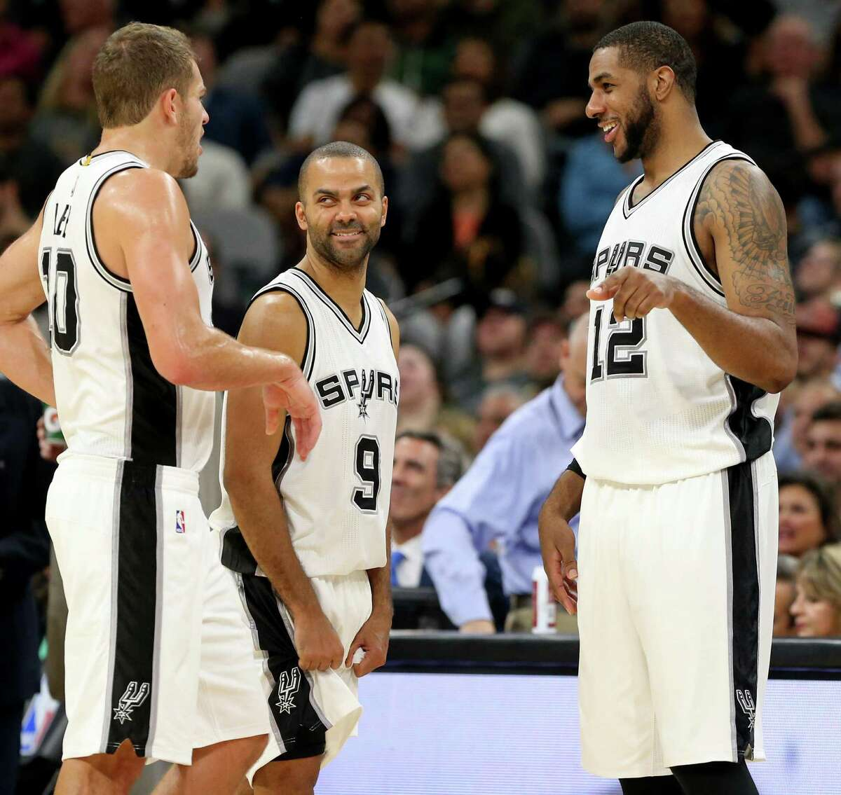 San Antonio Spurs' David Lee (from left), Tony Parker, and LaMarcus Aldridge talk during a second half timeout against the Miami Heat Monday Nov. 14, 2016 at the AT&T Center. The Spurs won 94-90.