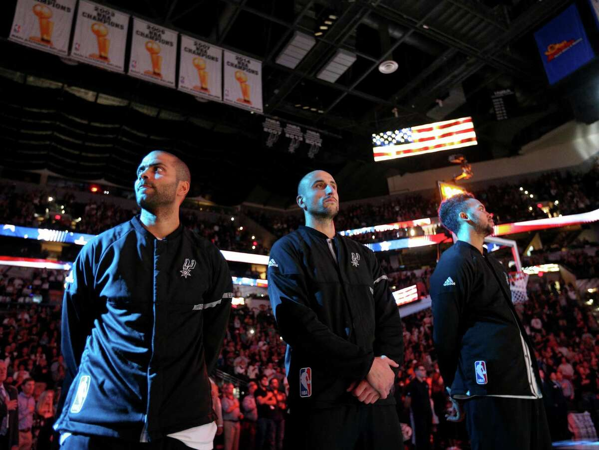 San Antonio Spurs' Tony Parker (from left), Manu Ginobili, and Kyle Anderson stand during the national anthem before the game with the Miami Heat Monday Nov. 14, 2016 at the AT&T Center.