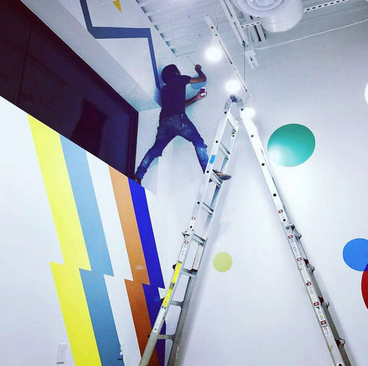 Birds is also known for its distinctive exterior and interior design work at each location, including murals inside and out. The Heights location is covered in vibrant dots, courtesy of Dandee Warhol at War'Hous Visual Studios.