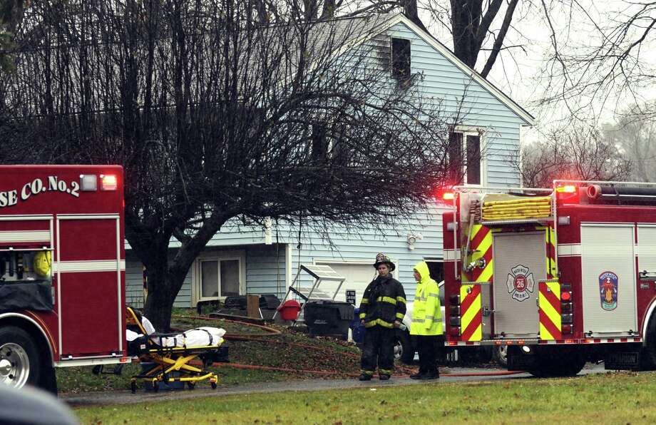 Authorities confirm that a woman died in a house fire on Carriage Drive in New Milford Tuesday, Nov. 29, 2016. Photo: Carol Kaliff / Hearst Connecticut Media / The News-Times
