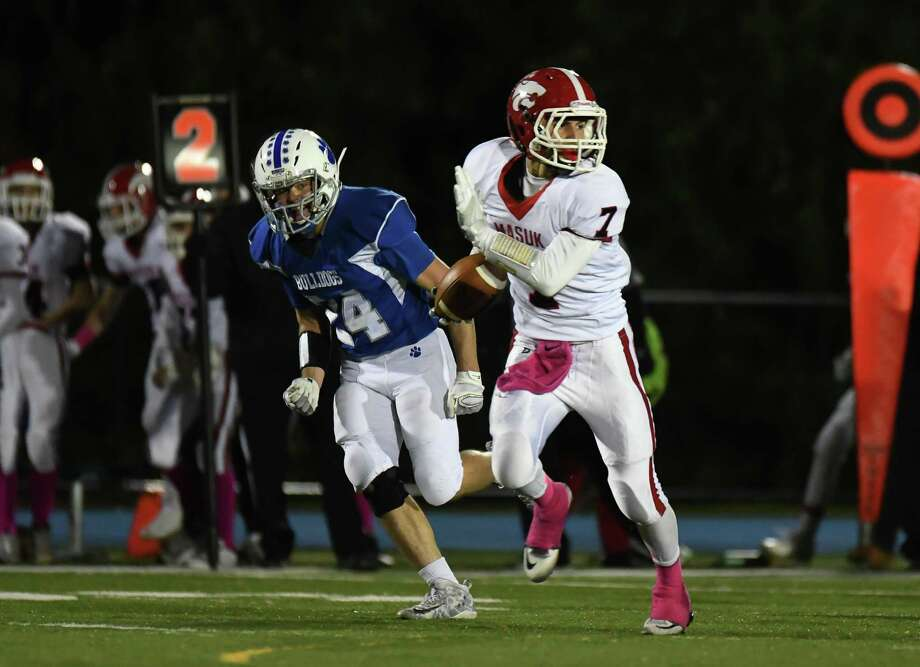 Nicholas Dellapiano (7) of the Masuk Panthers runs for a touchdown during a game against the Bunnell Bulldogs on Oct. 28 at Bunnell High School in Stratford. Dellapiano has rushed for 431 yards and seven touchdowns on the ground. As a receiver, Dellapiano has 561 yards and nine touchdowns. Photo: Gregory Vasil / For Hearst Connecticut Media / Connecticut Post Freelance