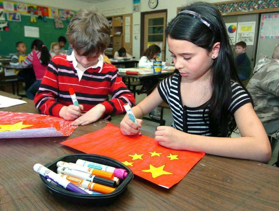 From left, Joseph Waldron and Julia Coelho, both 8 and from Mill Ridge Intermediate School in Danbury, work at school Jan. 31, 2008. Photo: Chris Ware / The News-Times