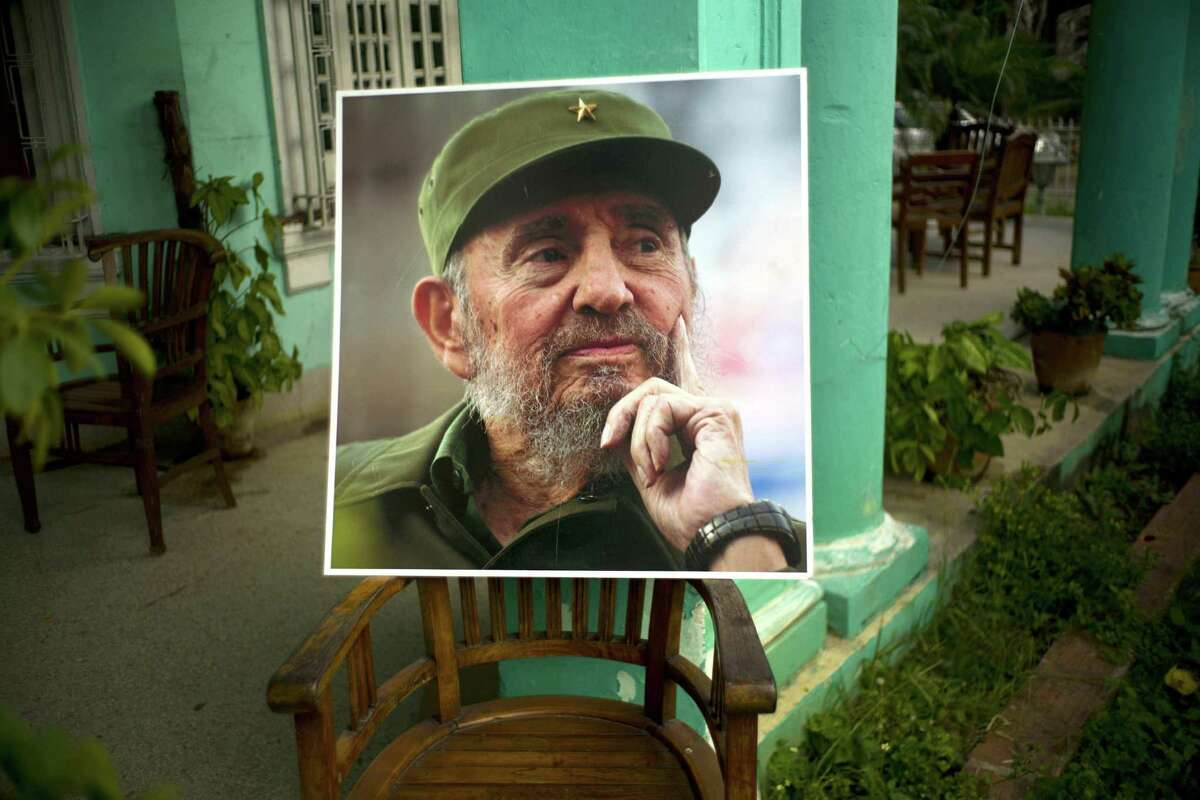 An image of the late Fidel Castro stands on a chair in a government building in Havana, Cuba, Sunday. Castro was the major architect of Cuba's woes, with his virulent anti-Americanism that shut the door on commerce with a neighbor 90 miles away, an alignment with the Soviet Union that brought the world to the brink of nuclear war, his export of revolution abroad, brutalization of his own people and his failure to liberalize either political or economic structures.