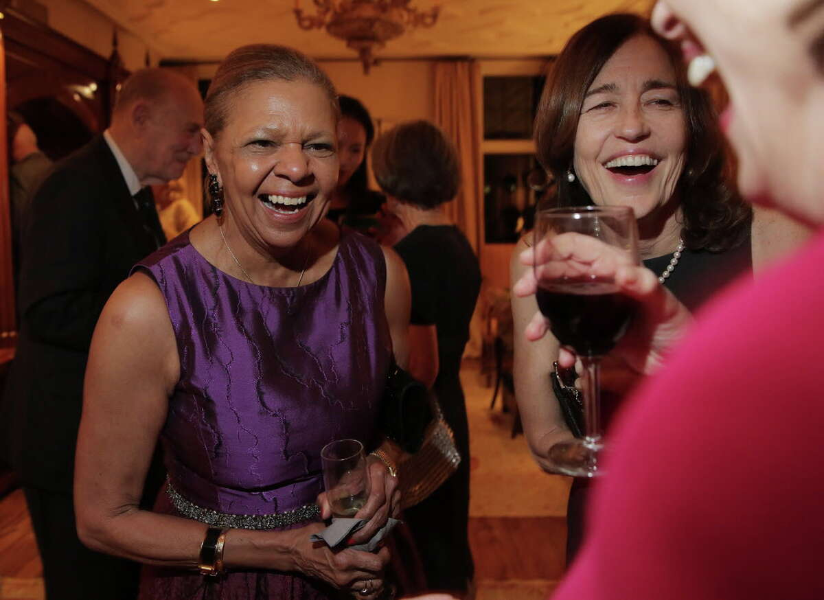 Yvonne Cormier, from left, shares a story with Andrea White and Lois Stark before the announcement of Lynn Wyatt as the 2017 Texas Medal of Arts Award honoree for Individual Arts Patron a party for the announcement at Phoebe and Bobby Tudor's home on Monday, Nov. 28, 2016, in Houston.