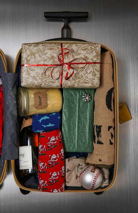 Don't do this: If you're taking carry-on luggage for holiday travel, leave out the family-recipe soup and the bottle of bubbly; if you have to wrap gifts (TSA agents might ask you to unwrap them), leave off the bows and ribbons; and make sure anything delicate or valuable is kept with you. Photo: Russell Yip, The Chronicle