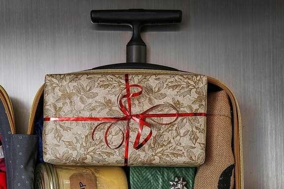 Don't do this: If you're taking carry-on luggage for holiday travel, leave out the family-recipe soup and the bottle of bubbly; if you have to wrap gifts (TSA agents might ask you to unwrap them), leave off the bows and ribbons; and make sure anything delicate or valuable is kept with you.